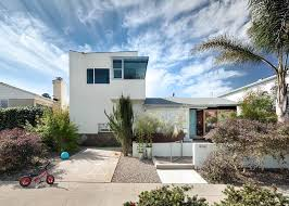 an eye catching san diego addition with a curved two story garage