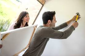 how to hang a painting how to hang picture frames mistakes to avoid reader s digest