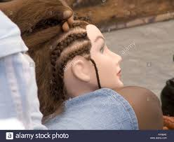 practicing braiding on a mannequins head stock photo
