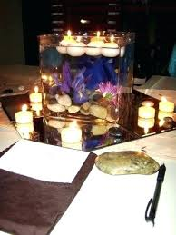 small tea light candles floating votive candles candle centerpiece ideas love the mirror