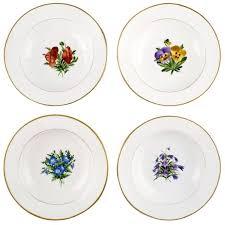 four antique royal copenhagen plates in flora danica style