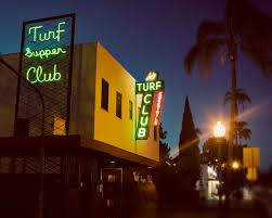 turf supper club vintage neon sign at night san diego home
