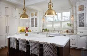 brown kitchen island with brass industrial pendant lights