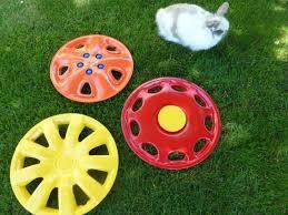 Fun Things To Have In Your Backyard Hubcap Flower Yard Art Hometalk