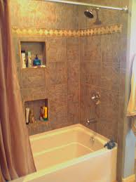 fiberglass tub with tile surround and shampoo niches tile