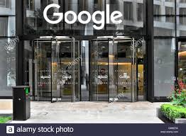 glass doors to google offices with sign above revolving entrance