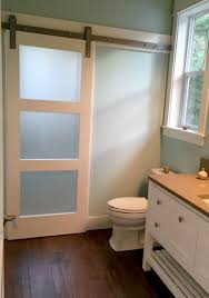 Frosted Glass Barn Door adds privacy to shower room on other side