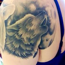 wolf howling moon tattoos and the moon on