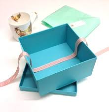 gift box gift wrapping project lining gift boxes with tissue and ribbon