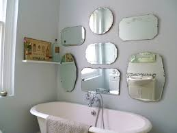 bathroom mirror fixings how to hang a display of vintage mirrors decorator s notebook