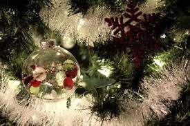 picture of brown christmas tree make a christmas tree look fuller with garland