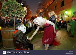 young with witch makeup reaching for a child with