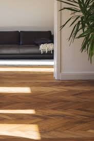 Laminate Flooring For Walls Laminate Flooring In A Multi Colored Living Room Decor
