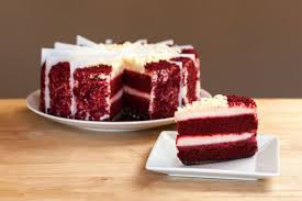 red velvet cheesecake whole sliced plated with slice in front