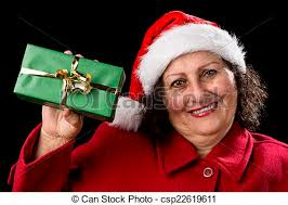 what to get an elderly woman for christmas elderly woman holding up a green wrapped gift middle