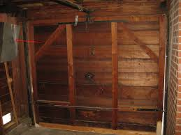 remodelaholic faux wood carriage garage door tutorial first paint