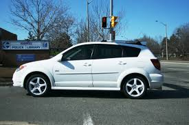 teal car white rims white pontiac vibe with white rims 2 madwhips