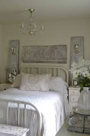 White Shabby Chic Bedroom by Farmhouse Bedroom Salvaged Architectural Pieces And Mismatched
