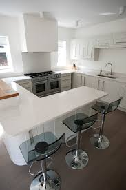 painted cream shaker kitchen with oak breakfast bar and quartz