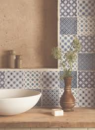 a mix of patchwork blue and white tiles handmade patterned
