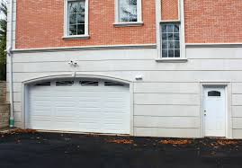 fatezzi faux wood garage doors brick home with using precast concrete wall panels for siding
