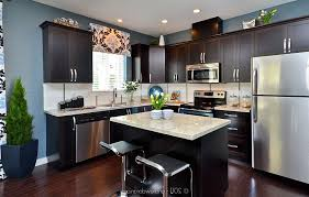 kitchens with dark cabinets and light granite countertops