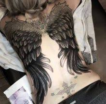 black and white s wing on back liked on