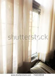 sad window seethroughsheer curtains daybed pillow stock photo