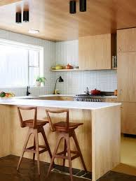 laminate island and mid century modern chairs for small kitchen