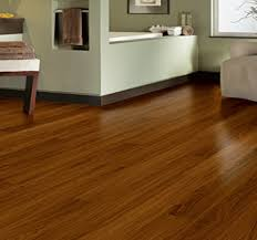modern baseboard brown wooden allure vinyl plank flooring matched with olive wall