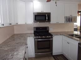 What Color Kitchen Cabinets Go With White Appliances Kitchen White Kitchen Cabinets With Gas Range Hood Sink Faucets