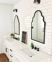 bright white bathroom double vanity tile wall bathroom