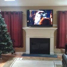 Home Design Experts Llc Home Decor Fireplace Mantels With Tv Above Interior Home Design