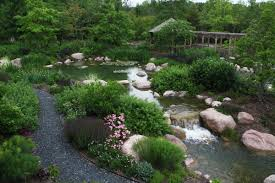 koi pond and waterfalls with outdoor kitchen water feature and