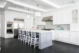 gray center island with white bamboo counter stools transitional