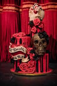 stunning floral rose and butterfly chocolate skull wedding cake