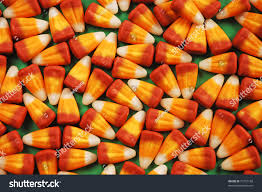 kids halloween candy background orange and yellow halloween candy corn on green background stock