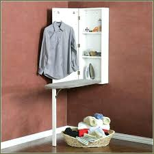 wall mount ironing board cabinet white hidden ironing board cabinet the design ironing board in wall
