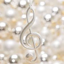 silver treble clef ornament at the stand