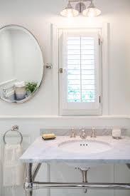 Bathroom Window Trim Bathroom Window Dressed In Plantation Shutters Over Vanity