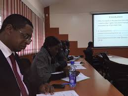 Dr  Muigua listens to presentation of Thesis Proposals by PhD Candidates    July