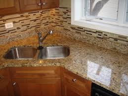 Kitchen Backsplashes With Granite Countertops by Giallo Ornamental Granite Countertop And Matching Glass Backsplash