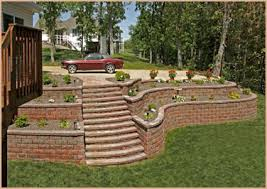 Tiered Backyard Landscaping Ideas Tiered Stone Retaining Wall Supporting Driveway With Steps To