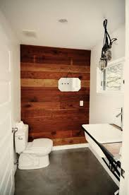 small bathroom designs with corner toilet and wooden wall panel