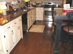 Cream Colored Kitchen Cabinets With White Appliances Antique White Cabinets With Black Appliances Love This Color Of