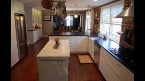 maple wood grey shaker door long narrow kitchen island backsplash maple wood grey shaker door long narrow kitchen island backsplash cut tile glass sink faucet lighting flooring limestone countertops