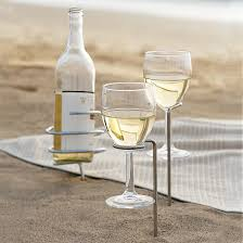 outdoor wine glass holder table beach blanket and wine sounds romantic and those spike things