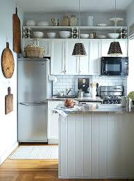 pictures of small kitchens with dark cabinets white and black