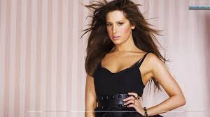 ashley tisdale wallpapers ashley tisdale sitting and smiling blue jeans wallpaper