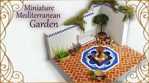 miniature mediterranean inspired garden w fountain polymer